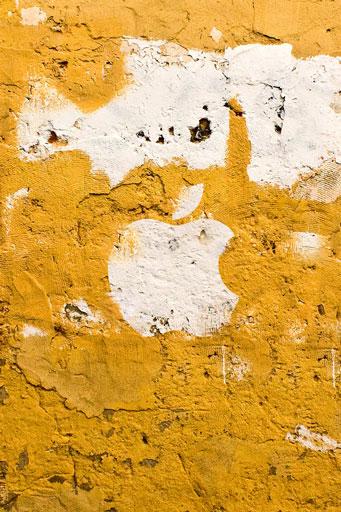 Apple Logo on Yellow Wall Wallpaper